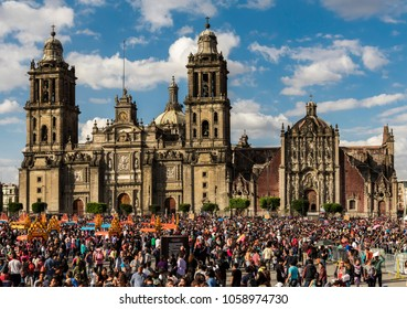 Mexico, Mexico City, 29 October 2016:  people partying in the square of Mexico City, Zocalo, colorful urban people and furnishings, cathedral background, sky with clouds