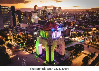 Mexico City, Mexico, aerial view of architectural landmark Monumento a la Revolucion at Plaza de la Republica at dusk.