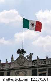 Mexico City. April 12, 2016. Mexican flag seen from the Contitution Square (Zocalo), hoisted in the Presidential Palace.