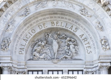 MEXICO CITY, MEXICO - APRIL 19, 2017: Intricate sculptures compliment the name Palacio de Bellas Artes of neoclassical architectural style of this cultural center in Mexico City.