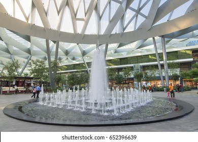 MEXICO CITY, MEXICO - APRIL 20, 2017: Toreo Parque Central shopping center in Mexico City features a huge park and beautiful fountain in the center beneath a modern architecture style glass ceiling.