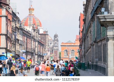 Mexico City, Mexico. April 2016. Residents and tourists walking the streets of the historic area of Mexico City on a sunny day.