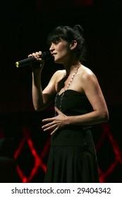 MEXICO CITY - APRIL 21 2009: Singer Julieta Venegas performs during The Chavela Vargas 90th Aniversary homage at the Teatro de La Ciudad de Mexico on April 21, 2009 in Mexico City, Mexico.