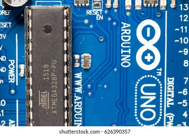 MEXICO CITY, MEXICO - APRIL 22,  2017: Photo of Atmel microcontroller on Arduino board, details of printed circuit board