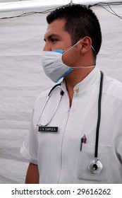 MEXICO CITY - APRIL 29: Close up of doctor J.A. Campos at a makeshift tent clinic in downtown Mexico City, treating patients suspected of H1N1 swine flu influenza on April 29, 2009 in Mexico City.
