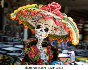 Mexico City, Mexico - April 30, 2017: La Calavera Catrina -Mexican colorful traditional souvenirs. The symbol of the holiday of the day of the dead.