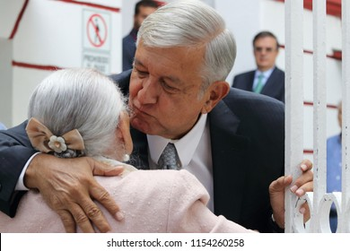 MEXICO CITY - AUG 02, 2018: President-elect Andres Manuel Lopez Obrador kisses elderly person who came to him for help in the transition house