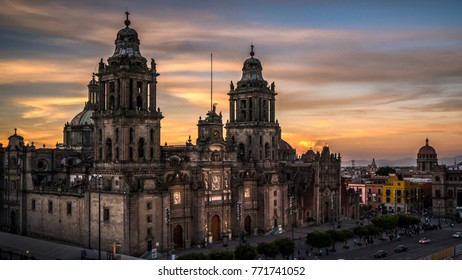 MEXICO CITY, MEXICO - AUGUST , 2017 : Sunset at Mexico City Metropolitan Cathedral at the Zocalo (city square) in Mexico City.  The Zocalo is one of the city's most popular visitor attractions.
