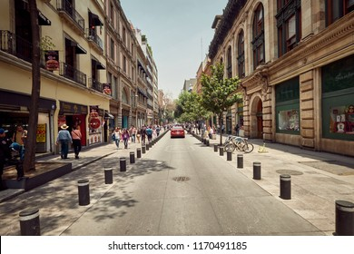 Mexico City, Mexico - August 22, 2018: Urban scene with people from downtown Mexico City, Mexico in Summertime. Roads, traffic, sidewalks, everyday life.