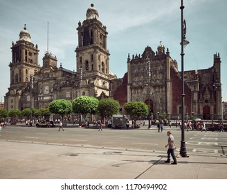 Mexico City, Mexico - August 22, 2018: The Metropolitan cathedral and the people walking in the surrounding area. It is a Catholic church with many ornate chapels and is the Latin America's oldest & l