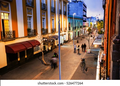 Mexico City is the capital of Mexico. Nightlife in Mexico City. Streets of the center with blurred people, bars, restaurants and cafes.