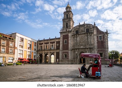 Mexico City, CDMX - Mexico - 05-12-2017: A shoeshiner at work in Santo Domingo Plaza in the Historic Center of Mexico City during a clear morning