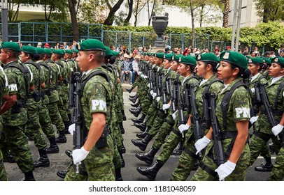 Mexico City, CDMX, Mexico 9/16/18  Mexico Military Civic Parade 2018 Soldiers from the Military Police marching in front of the crowd with their weapons over Reforma avenue