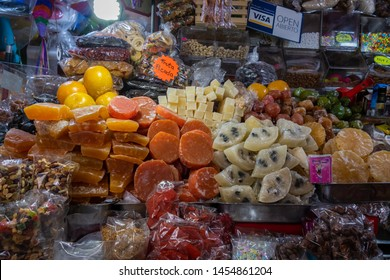 MEXICO CITY, CDMX / MEXICO - July 03, 2019: Crystallized fruit or candied fruit in the main market in downtown Coyoacan in Mexico City.
