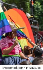 MEXICO CITY, CDMX / MEXICO - June 29, 2018: Mexican cowboys and charros carry the LGBTQ flag during the LGBTQ Pride Parade.