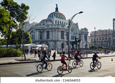 Mexico city, CDMX Mexico7/28/18 People riding bicycles in front of the Palace of Fine Arts by the Alameda during the Sunday Promenade organized by the Ministry of Environment of Mexico city every week