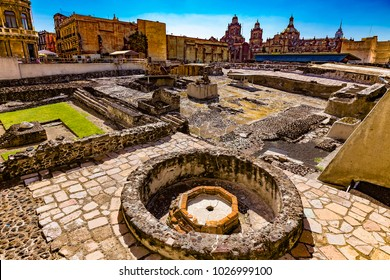 Mexico. The City of Mexico (CDMX). The ruins of the Templo Mayor (UNESCO World Heritage Site). There is the Mexico City Metropolitan Cathedral in the background