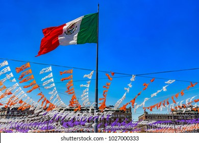 Mexico. The City of Mexico (CDMX). The Zocalo (Constitution Square), the main square of Mexico City with huge great Mexican flag streaming in the wind