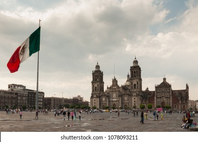 MEXICO CITY / MEXICO - Circa 2014: A view from the Zocalo, main square of Mexico city. On the left is the flagpole with a mexican flag and the building in the right is the Mexico city's cathedral.