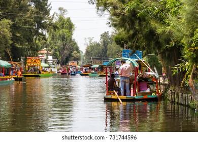 MEXICO CITY, MEXICO - CIRCA APRIL 2016: Trajineras (boats) at Xochimilco. Xochimilco is one of the most popular tourist attractions in the city.