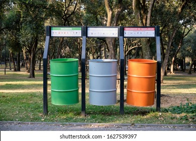 Mexico City, Mexico - Circa January, 2020. Three large waste container for selective rubbish collection in a Mexico city park, in the colours of the National Flag.