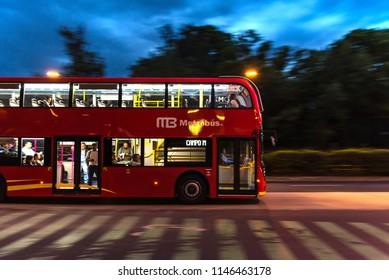 Mexico City, Mexico - Circa july 2018: Public transportation - Double decker Metrobus at Reforma avenue, night scene