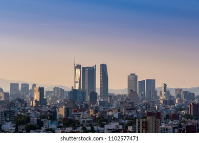 MEXICO CITY, MEXICO - CIRCA MAY 2018: Sunset at the city, panoramic view of main buildings and skyscrapers