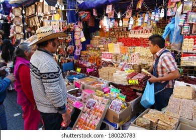 MEXICO CITY - DEC 08: Mexicans in a street market near Plaza de las Americas. Millions of pilgrims from all over Mexico visit basilica of Our Lady of Guadalupe, especially in  Feast day.
