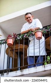 MEXICO CITY, MEXICO - DEC 29, 2011: Unidentified Mexican man smiles on the balcony. 60% of Mexican people belong to the Mestizo ethnic group