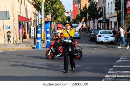 MEXICO CITY, MEXICO - DECEMBER 09, 2016 : Traffic cop in the street of  Mexico City