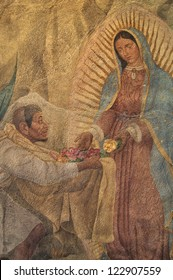 MEXICO CITY, MEXICO - DECEMBER 12: Painting of the Virgin Mary giving roses to Juan Diego  on the chapel wall on Tepeyac Hill on December 12, 2012 during the feast of Our Lady of Guadalupe