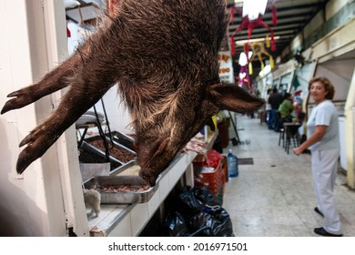 Mexico City, Mexico. DECEMBER 23, 2010. Wild boar hanging at San Juan's market, one of the most famous markets in Mexico City because of its unusual products.