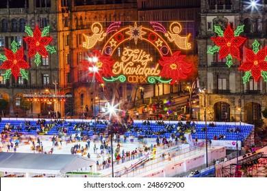 MEXICO CITY, MEXICO - DECEMBER 25, 2014 Mexico City Zocalo Christmas Night Celebration Ice Skating Rink,  Feliz Navidad is Spanish for Merry Christmas.