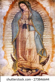 MEXICO CITY, MEXICO - DECEMBER 25, 2014 Original Virgin Mary Guadalupe Painting was revealed to Indian Peasant Juan Diego in 1531 to Catholic Bishop. New Shrine of the Guadalupe, Mexico City Mexico