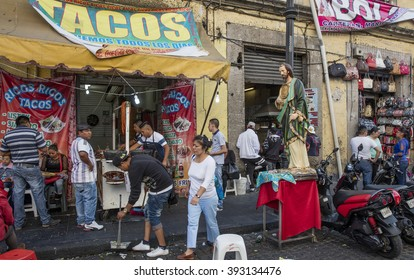 MEXICO CITY, MEXICO - DECEMBER 27, 2015; People near the Plaza de la Constitucion, the main square in front of Cathedral Metropolitana and Metropolitan Tabernacle.