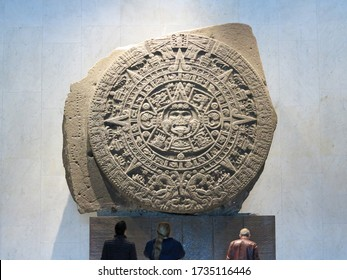 Mexico City, Mexico - December 29 2018 - People looking at The Aztec Sun Stone at The Museo Nacional de Antropología, also known as the National Museum of Anthropology, the largest museum in Mexico.