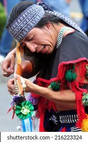 MEXICO CITY - FEB 23 2010:Mexican man play traditional music.Modern Mexicans are a unique blend of many ancient civilizations: Olmec, Zapotec, Toltec, Maya, Aztec, Inca, African, French and Spanish
