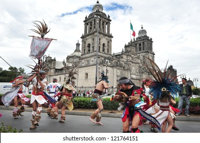 MEXICO CITY - FEB 23: Ancient Indian folklore dancers outside Catedral Metropolitana on February 23 2010 in Mexico City, Mexico. It's the oldest and largest cathedral in all of Latin America.