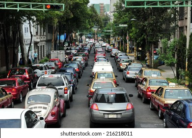 MEXICO CITY - FEB 24 2010:Traffic congestion in Mexico City.In 2012, there were 23,550,000 registered motor vehicles in Mexico.It's estimated that by 2018 there will be more than 35,495,000 vehicles.