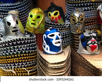 MEXICO CITY - February 17, 2018: A selection of colorful Lucha Libre Mexican professional wrestling masks, atop large sombreros, for sale at Ciudadela Market, a handicraft and folk art market.