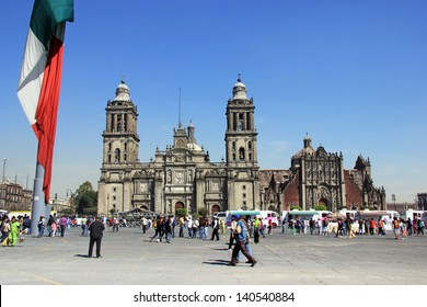 MEXICO CITY - FEBRUARY 2, 2013;  People  walk on the street on Plaza de la Constitucion,  in front of Cathedral Metropolitana and Metropolitan Tabernacle on february 2, 2013 in Mexico City, Mexico.