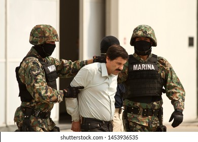 "Mexico City, Mexico February 22 2014 Joaquín Archivaldo Guzmán Loera ""El chapo"", a Mexican drug trafficker, is presented to the media in a hangar at the airport in Mexico City."