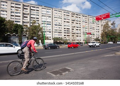 MEXICO CITY, MEXICO - FEBRUARY 8, 2018 - Cyclist and traffic in the Tlatelolco's neighborhood, Mexico City