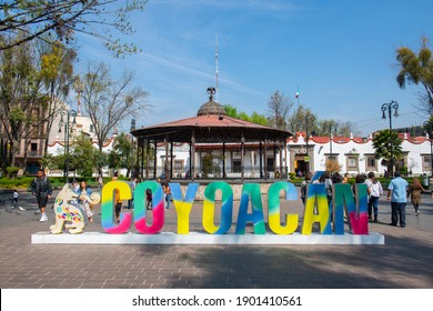 MEXICO CITY - JAN. 17, 2020: Coyoacan Sign and historic bandstand at Plaza Jardin Hidalgo in historic center of Coyoacan, Mexico City CDMX, Mexico.