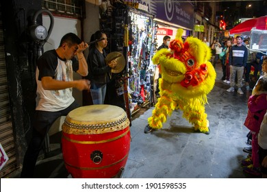 MEXICO CITY - JAN. 17, 2020: Lion Dance in Chinatown Barrio Chino on Dolores Street in historic center of Mexico City CDMX, Mexico. Historic center of Mexico City is a World Heritage Site.
