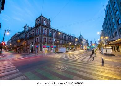 MEXICO CITY - JAN. 18, 2020: Historic buildings at night on Avenida Republica de Uruguay and Avenida 20 de Noviembre near Zocalo Constitution Square, Mexico City CDMX, Mexico. Historic center of Mexic