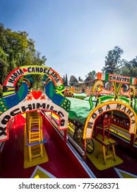 """Mexico City, Mexico, January 13, 2015. Colorful trajinera boats at the shore of system of canals known in Mexico City as  Xochimilco. The name """"Xochimilco"""" comes from Nahuatl and means """"flower field."""""""
