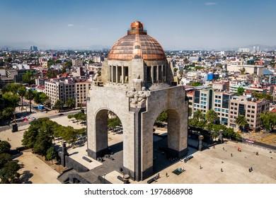 Mexico City, Mexico - January 23: Daytime aerial view of architectural landmark Monument to the Revolution (Spanish: Monumento a la Revolucion) at Plaza de la Republica in Mexico City, Mexico.