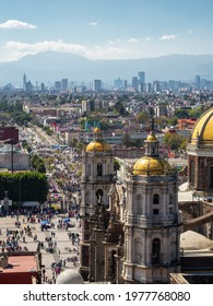 Mexico City, Mexico - January 28: Historical landmark Basilica of Our Lady of Guadalupe and CDMX skyline on a sunny day in Mexico City, Mexico.
