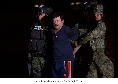 "Mexico City, Mexico January 8 2016 Joaquín Archivaldo Guzmán Loera ""El chapo"", a Mexican drug trafficker, is presented to the media in a hangar at the airport in Mexico City."